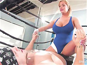 chesty platinum-blonde Shyla Stylez does some hardcore training