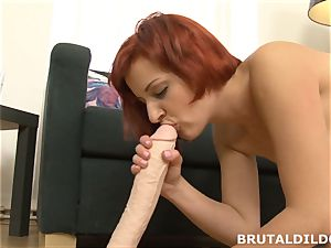 red-haired rotates inbetween mouth and cootchie with giant dildo