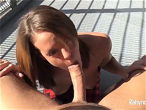 Rahyndee James dark-haired babe fellatio arched Over Balcony