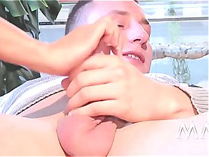 Ginger Gina caresses her honeypot and fellates on gigantic rod