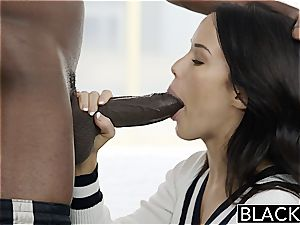 Megan Rain boinking a ebony rod