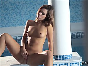 redhead Jenny Appach strokes by the pool alone